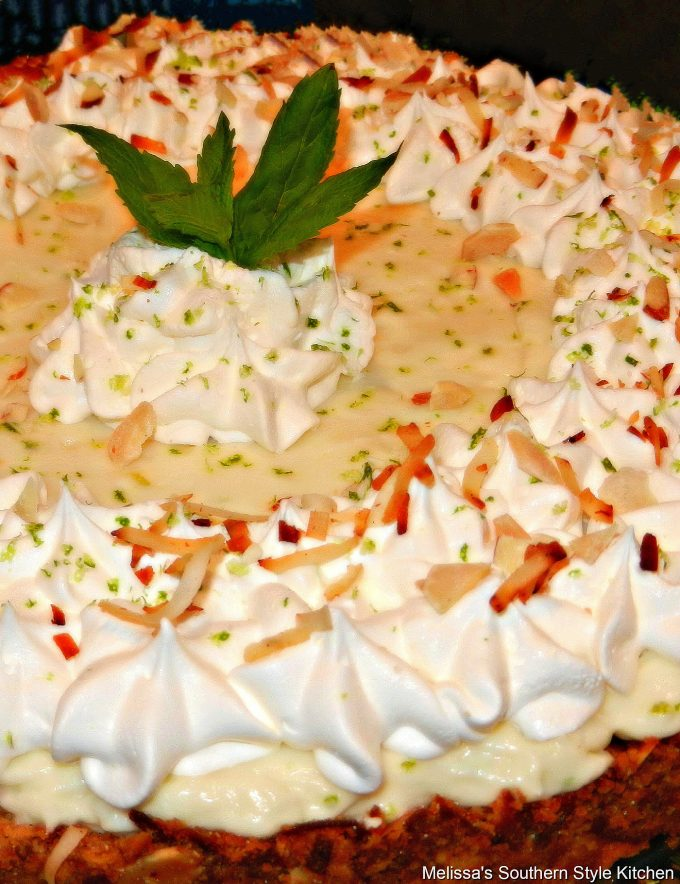 Key Lime Tart with whipped cream on a cake pedestal
