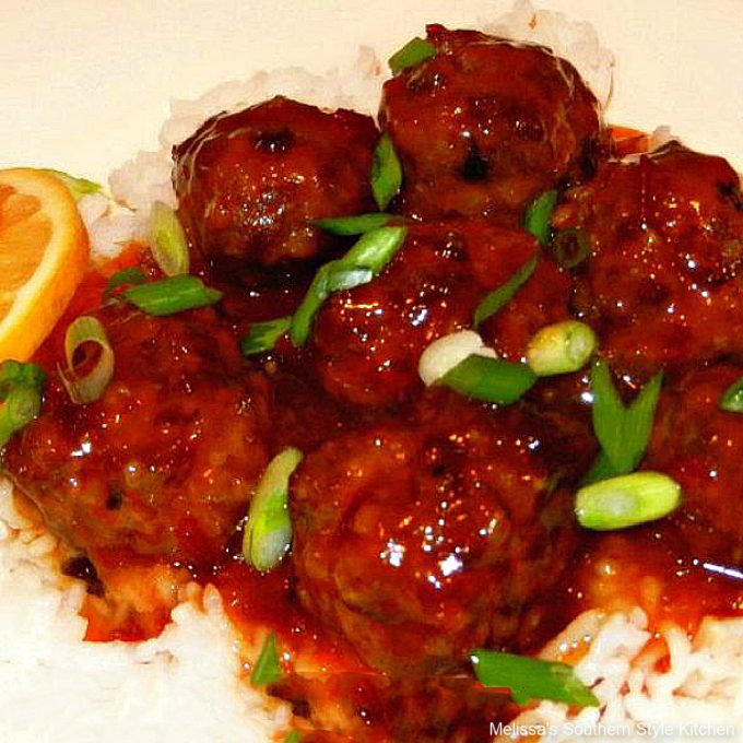 Slow Cooked Asian Meatballs on a platter with sauce and rice
