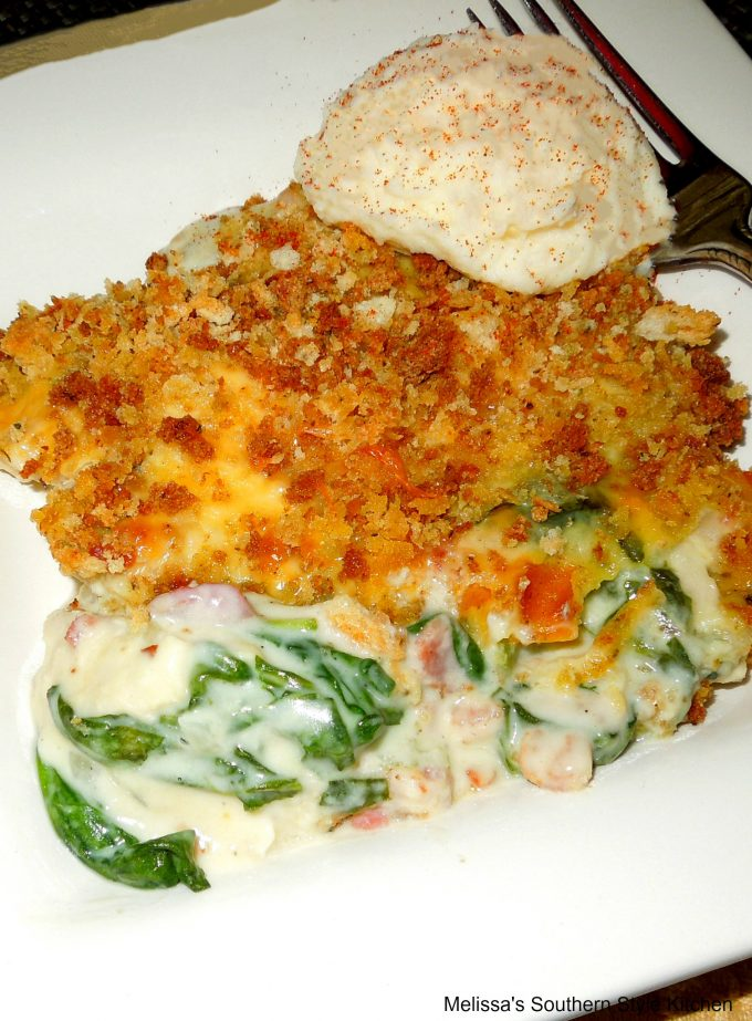 Turkey casserole on a plate with mashed potatoes