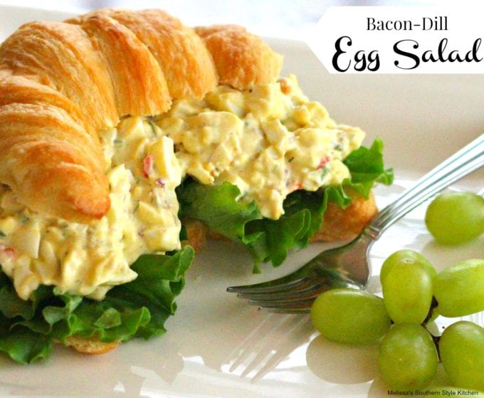 Bacon-Dill Egg Salad with Pimentos on a croissant on a plate