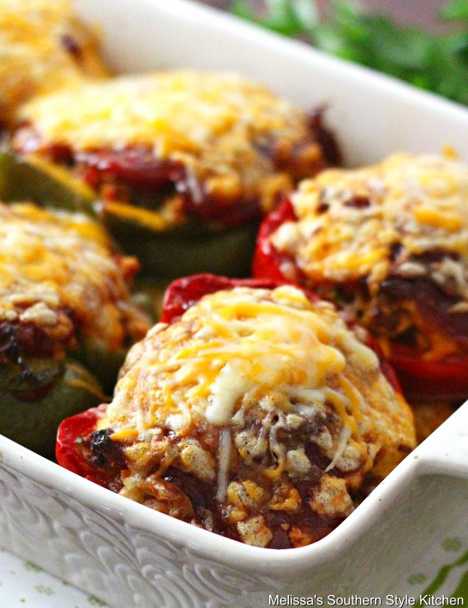 Stuffed Peppers topped with cheese in a baking dish
