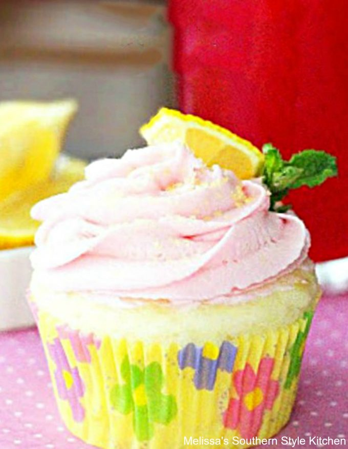 Cupcake on a plate with Pink Lemonade Cream Cheese Frosting