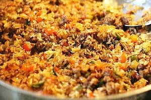 a skillet with Cajun Dirty Rice