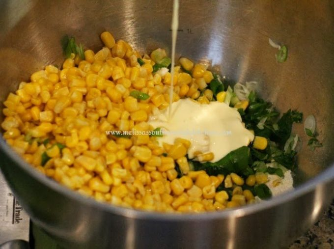 Ingredients for corn fritters in a mixing bowl