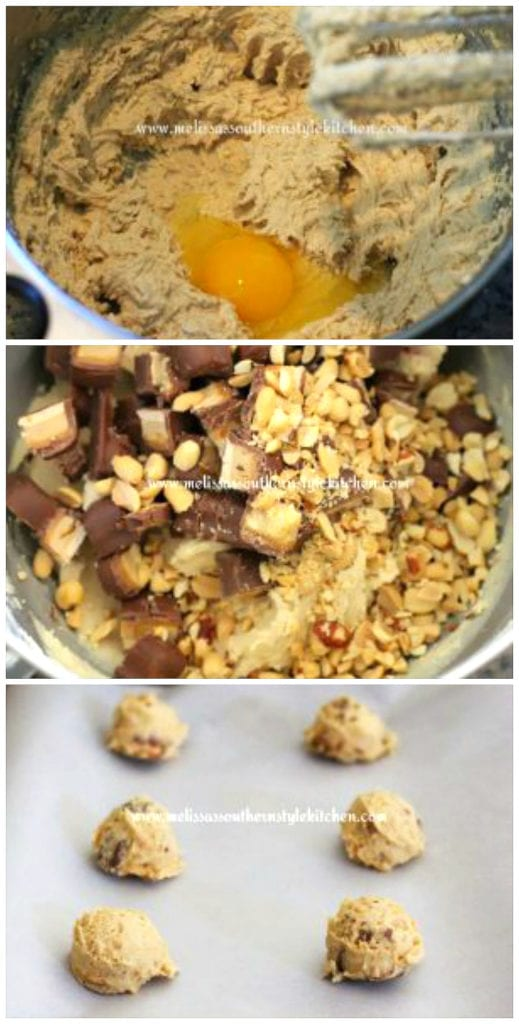 cookie dough in a mixing bowl with candy bar pieces and peanuts