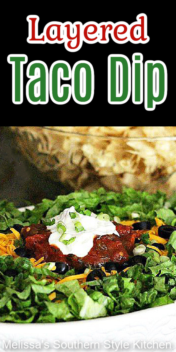 Make this festive Layered Taco Dip then grab a bag, or two, of tortilla chips and snack your way through the game this weekend #tacodip #mexicanfood #gamedayrecipes #appetizers #beandip #tacos #snacks #easytacodip #mexicandip