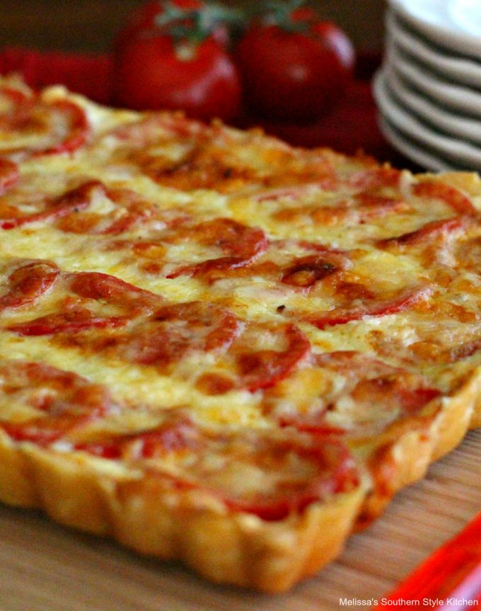 baked tomato tart on a cutting board