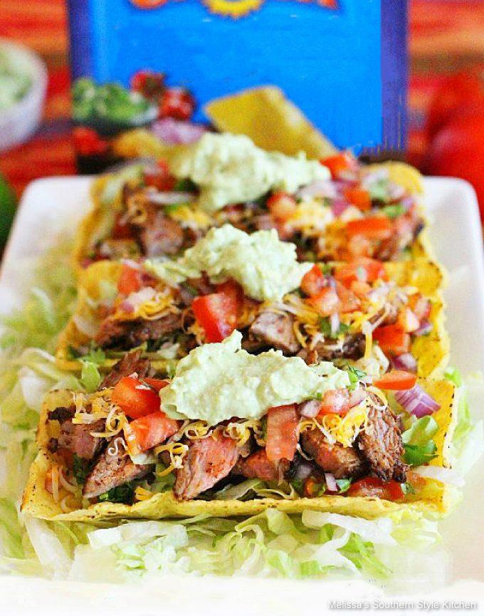 Chili Lime Skirt Steak Tacos on a white platter