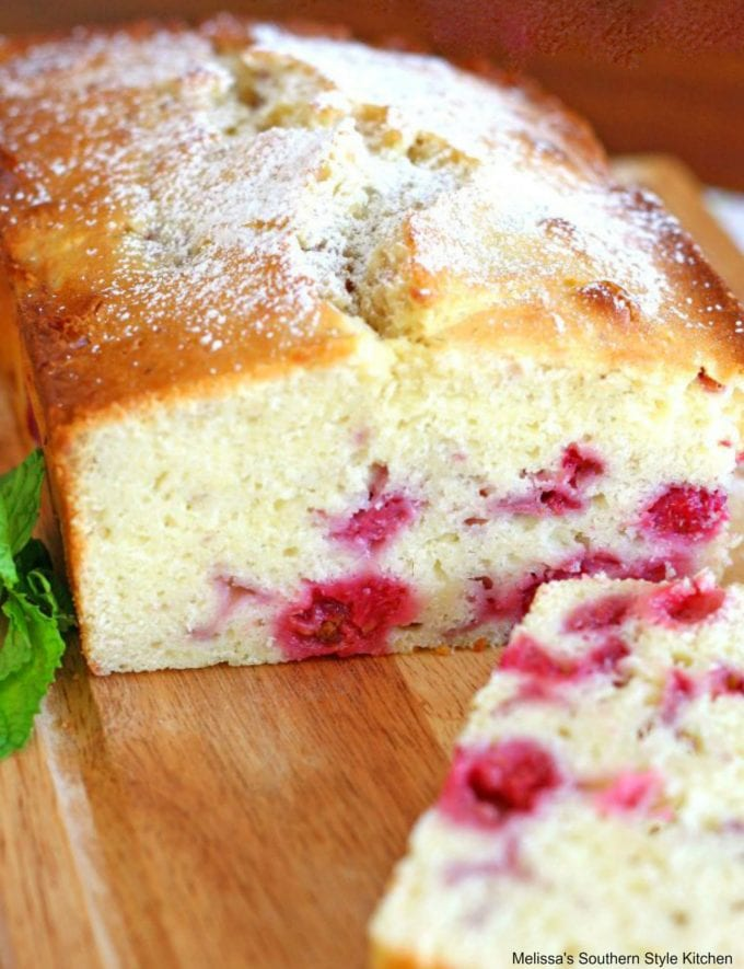 baked raspberry bread on a cutting board