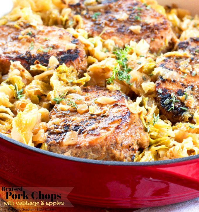 Braised Pork Chops with Cabbage and Apples in a skillet