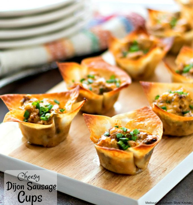 baked sausage cups on a platter