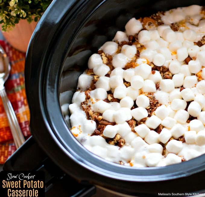 cooked sweet potato casserole with marshmallows and pecans