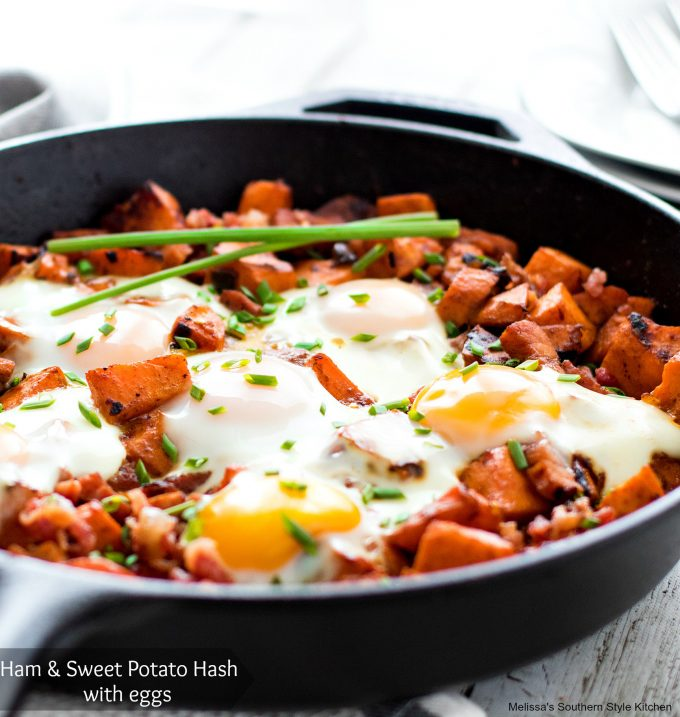 Ham and Sweet Potato Hash with Eggs in a cast iron skillet