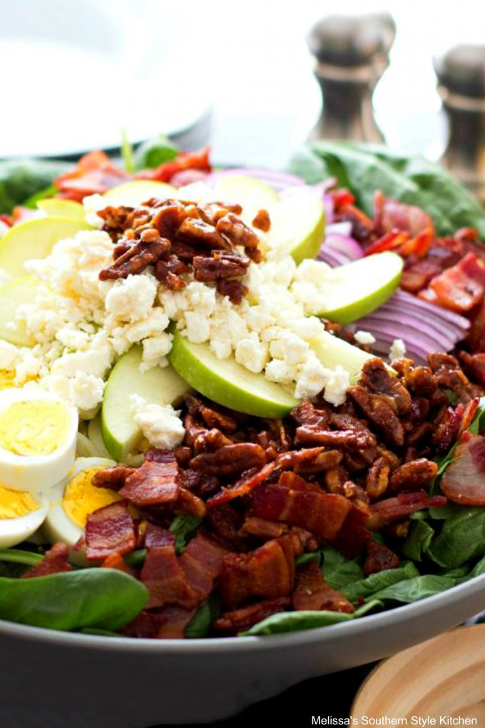 Spinach Salad with Honey Dijon Vinaigrette in a serving bowl