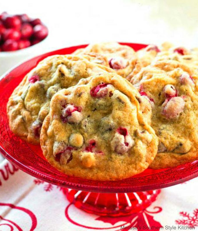 baked Cranberry Walnut Chocolate Chip Cookies on a cake stand