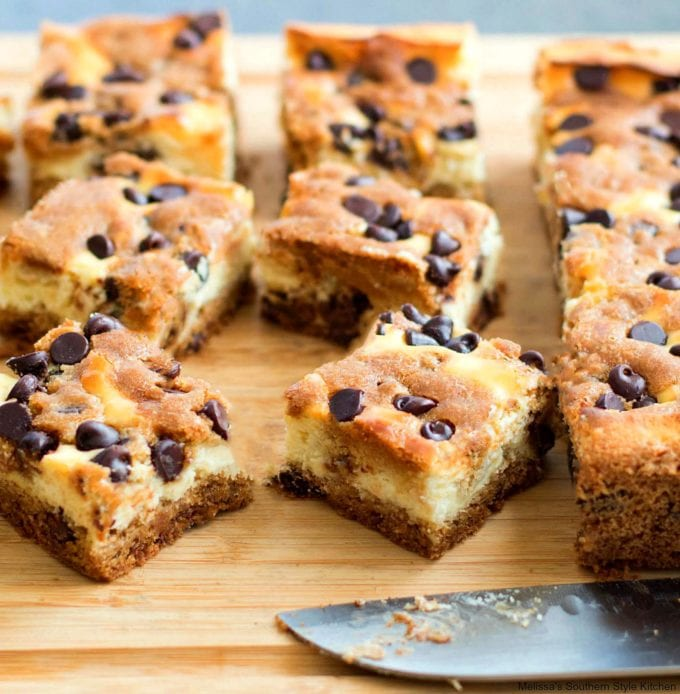 Chocolate Chip Cheesecake Bars on a cutting board