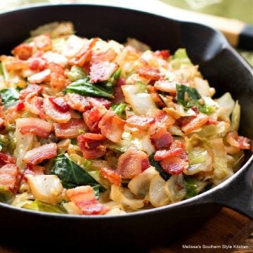 fried cabbage with bacon in a cast iron skillet