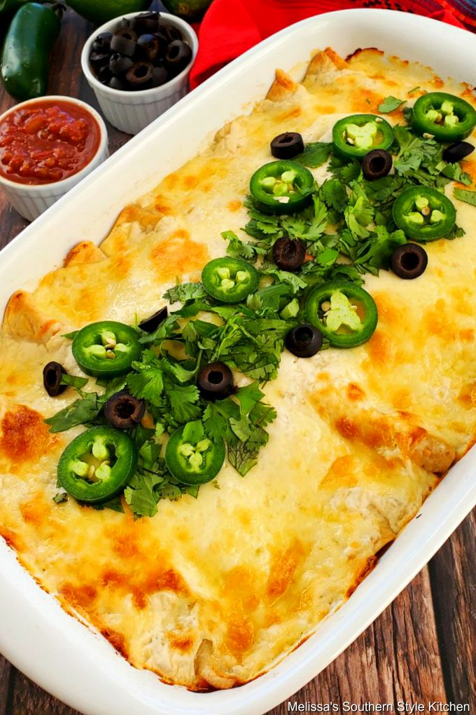 White Chicken Enchiladas with jalapeno slices, salsa, cilantro and salsa