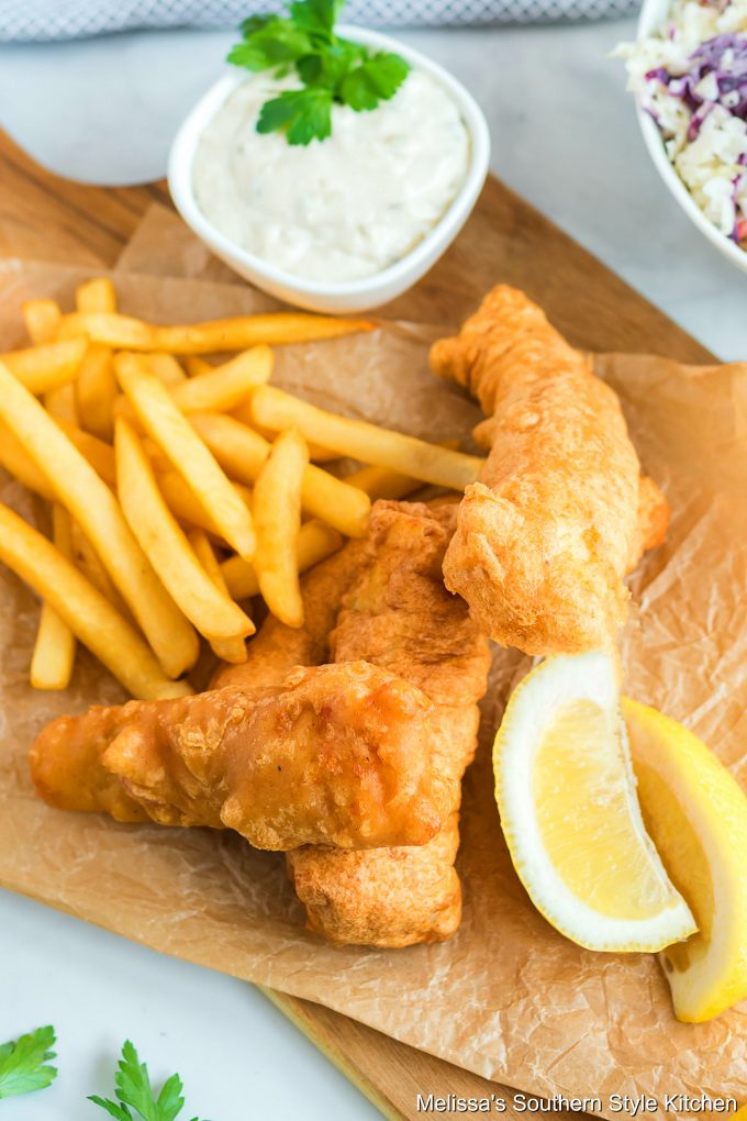 Beer Battered Fish and chips with tarter sauce on a platter