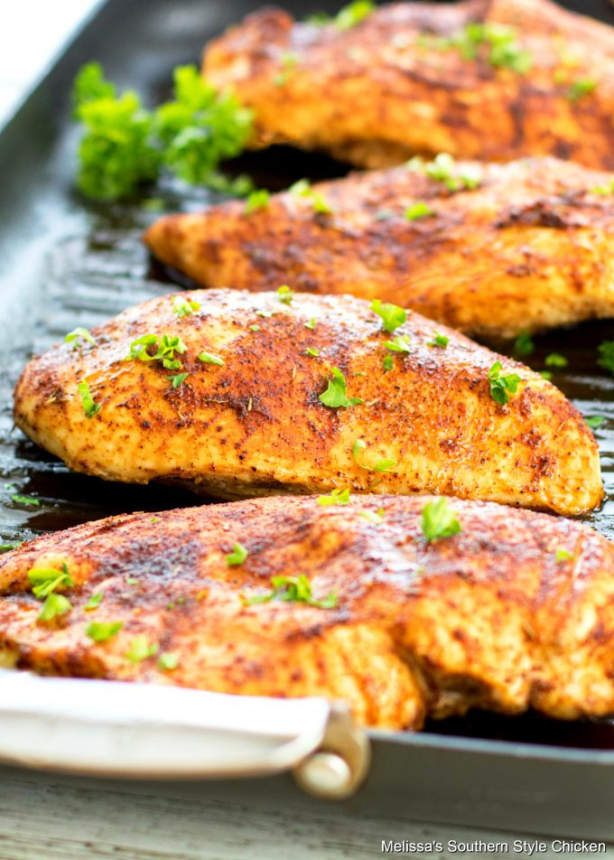 roasted chicken breasts on a grill pan