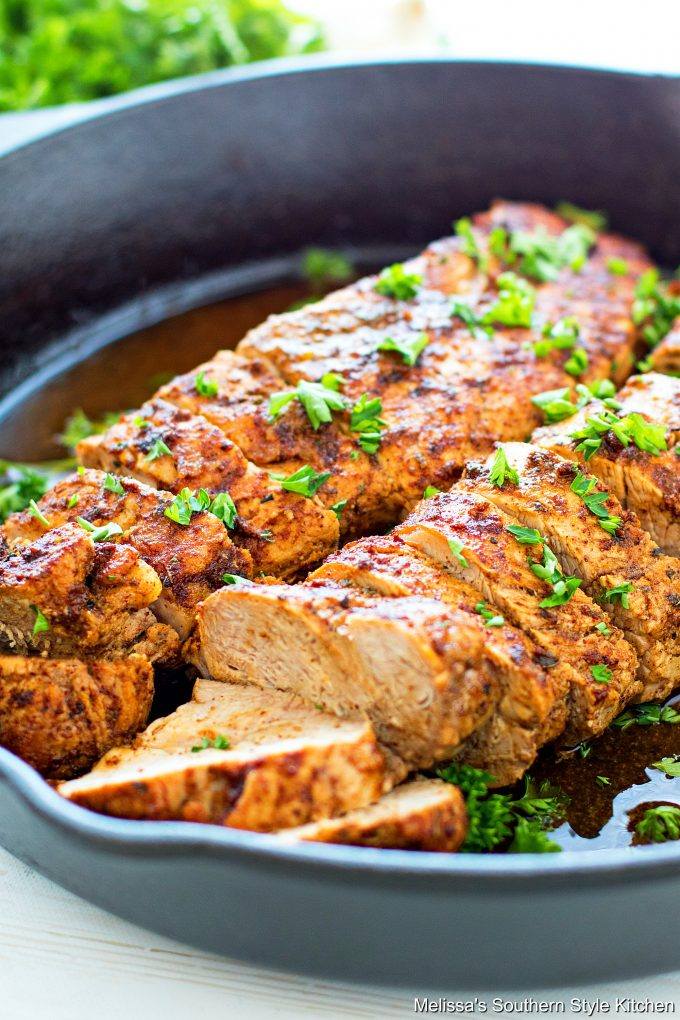 Baked and sliced pork tenderloin in a cast iron skillet