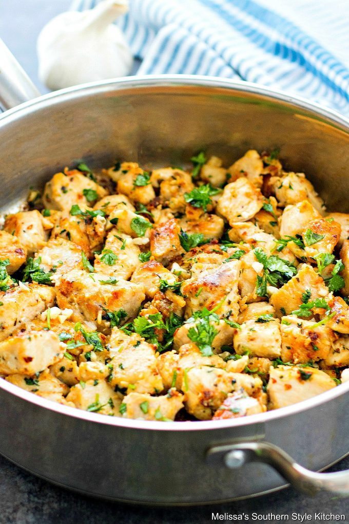 Garlic Butter Chicken in a skillet garnished with parsley