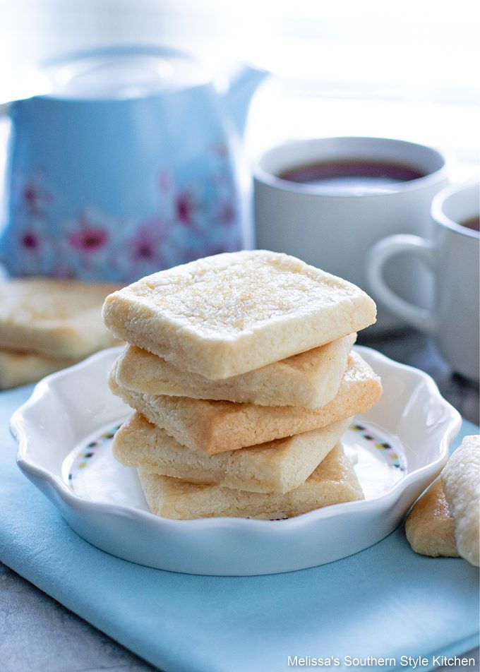 square shortbread cookies on a plate with coffee cups