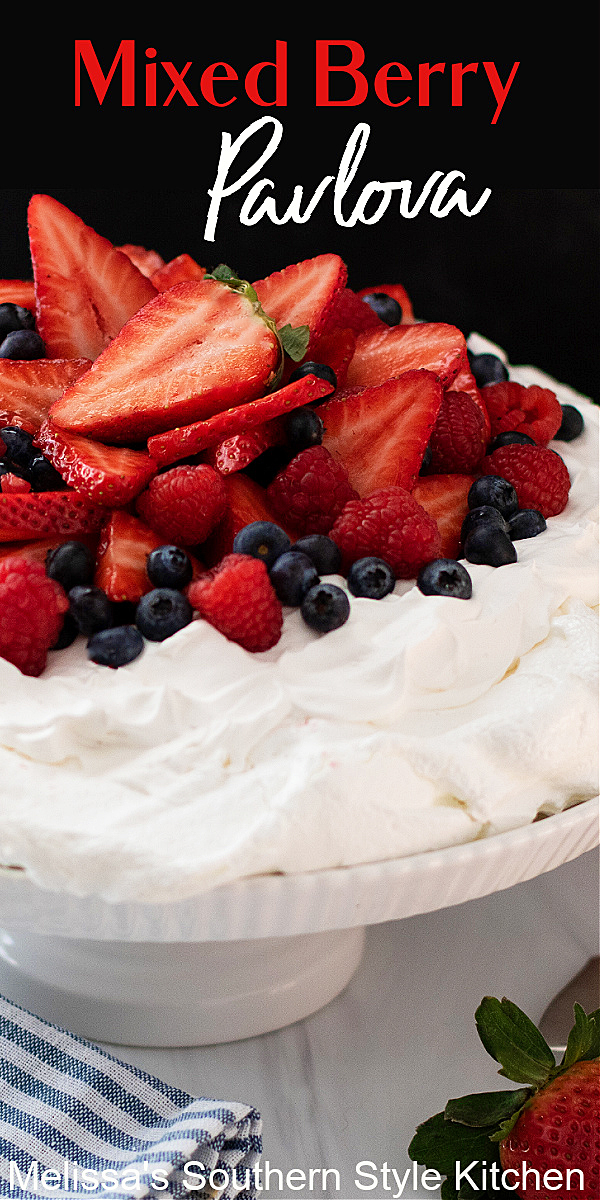 This billowy Mixed Berry Pavlova is a decadent dessert that's suitable for casual dining or entertaining #pavlova #mixedberries #easypavlova #pavlovarecipe #homemadewhippedcream #easydesserts #desserts #dessertfoodrecipes #southernrecipes