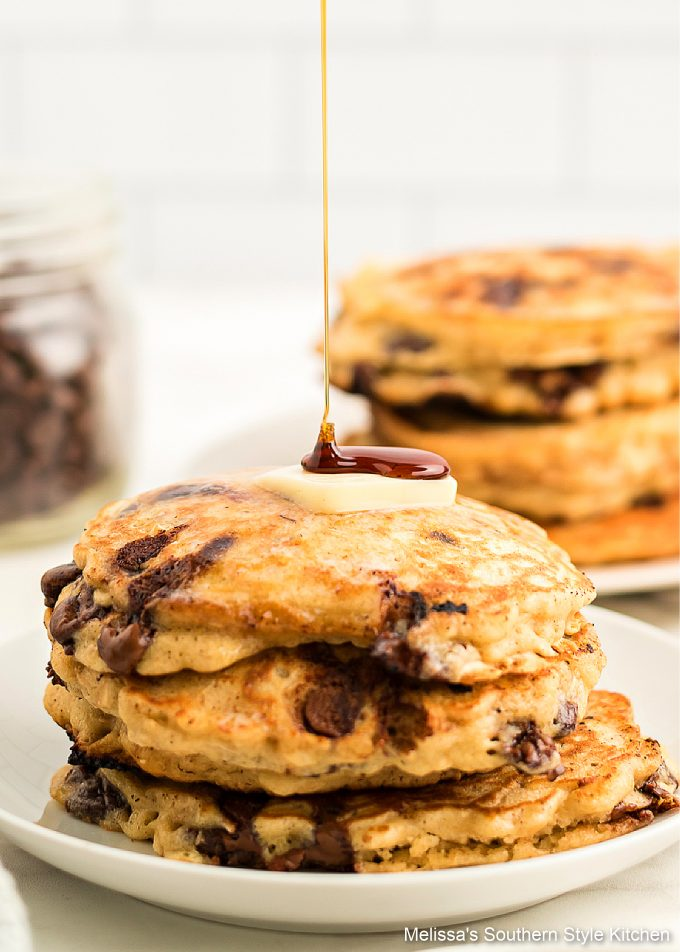 syrup drizzled Oatmeal Chocolate Chip Pancakes on a plate